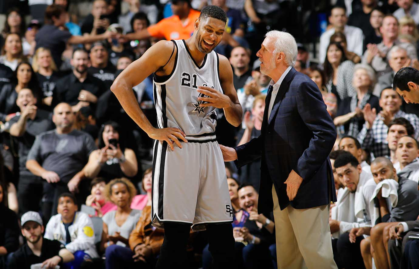 Tim Duncan and coach Gregg Popovich enjoy a lighter moment during San Antonio's 87-79 home win over Golden State.