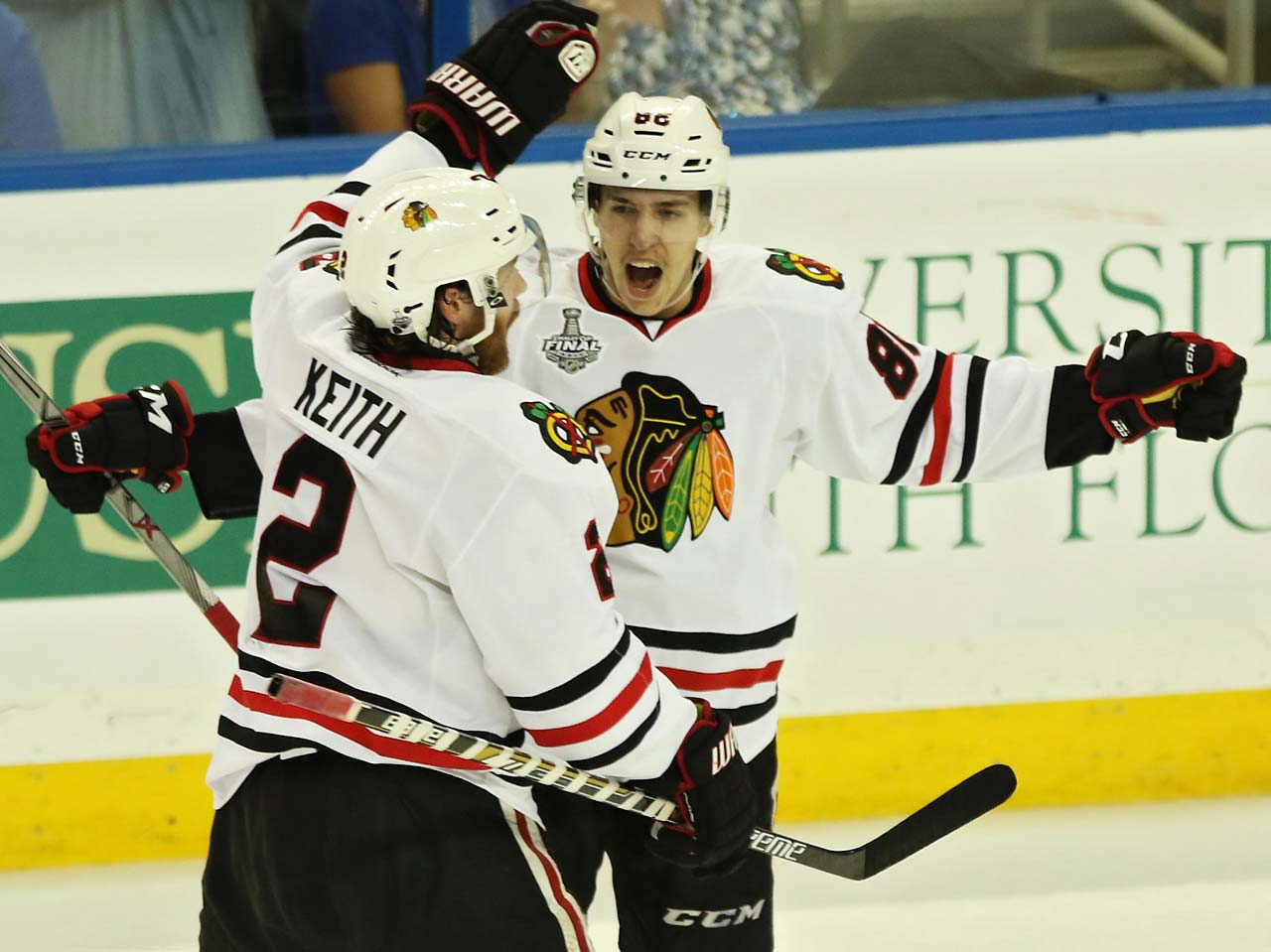 Teuvo Teravainen celebrates with Duncan Keith.