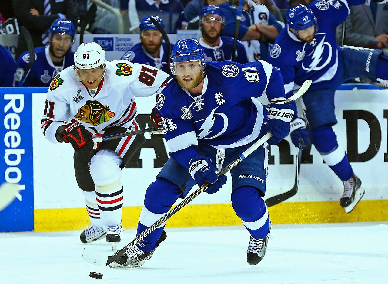 Steven Stamkos of Tampa Bay tries to put some distance between himself and Marian Hossa.