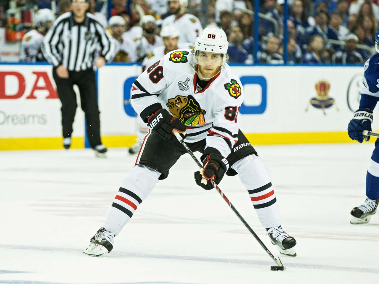 Patrick Kane skates with the puck in the first period.