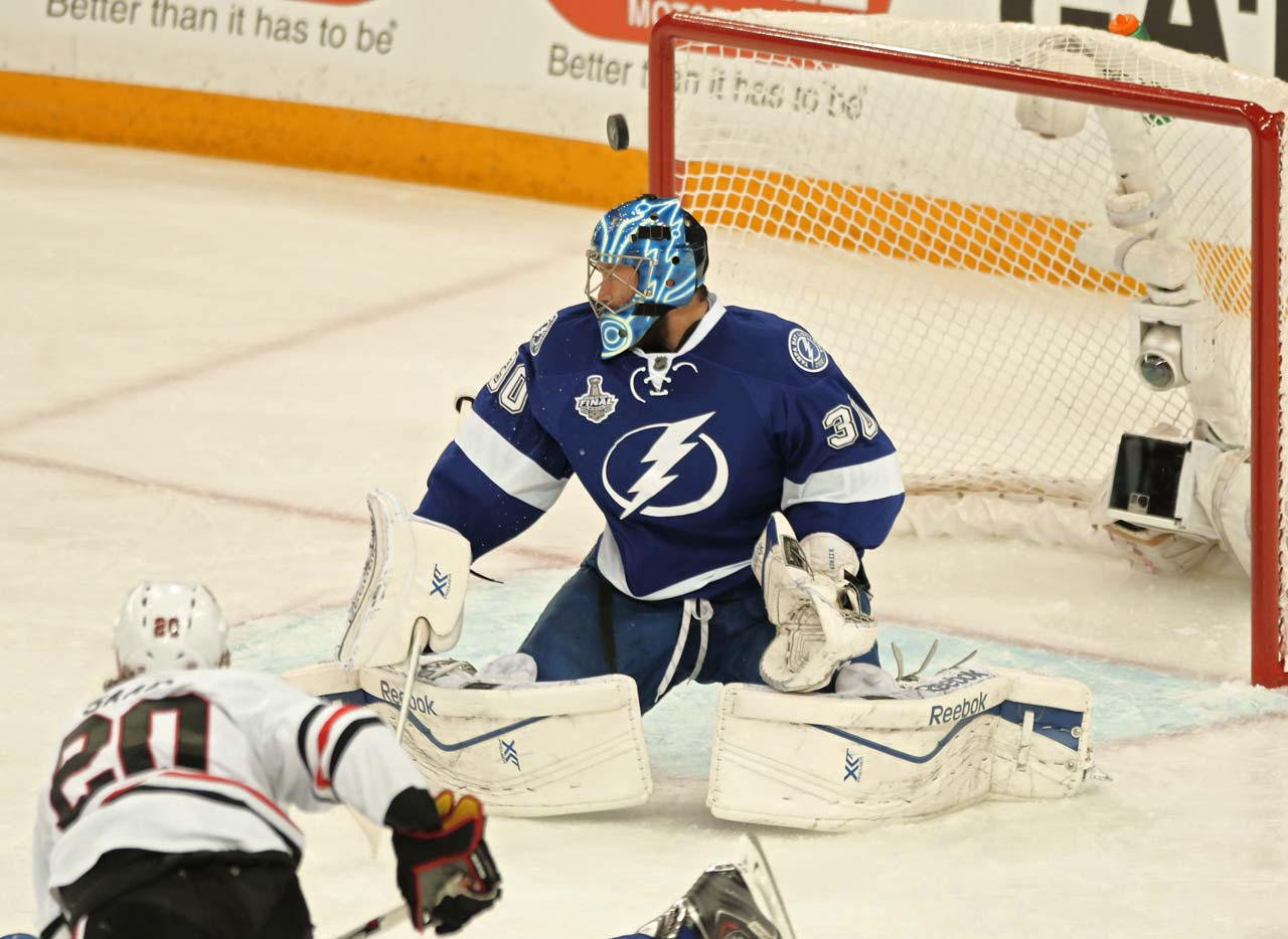 The puck floats above the head of Ben Bishop as he defends the net in the first period.