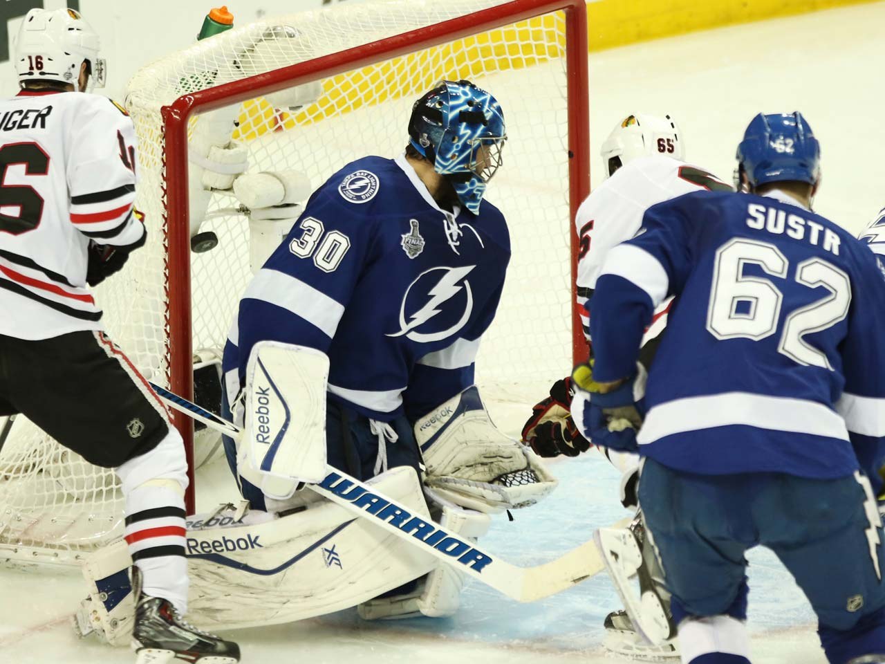 Ben Bishop of the Lightning looks the other way as the puck soars over his right shoulder.