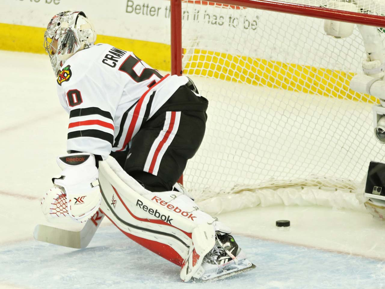 Corey Crawford stands up after he let the puck in for another Lightning goal.