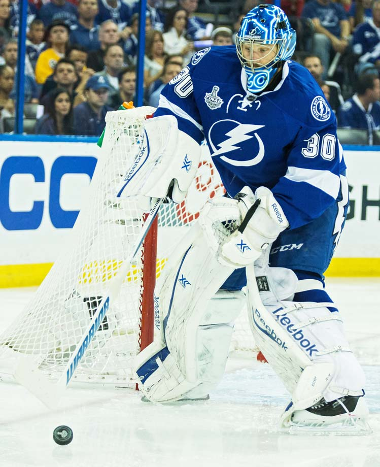 Ben Bishop swats the puck away with his stick early in the first period.