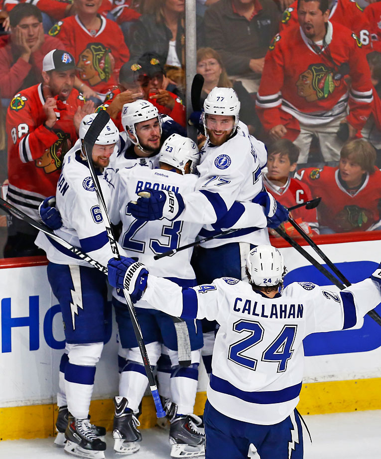 SI's Best Photos from Game 3: The Tampa Bay Lightning improved to 8-3 on the road in the playoffs with their 3-2 victory in Chicago in Game 3 of the Stanley Cup Final.