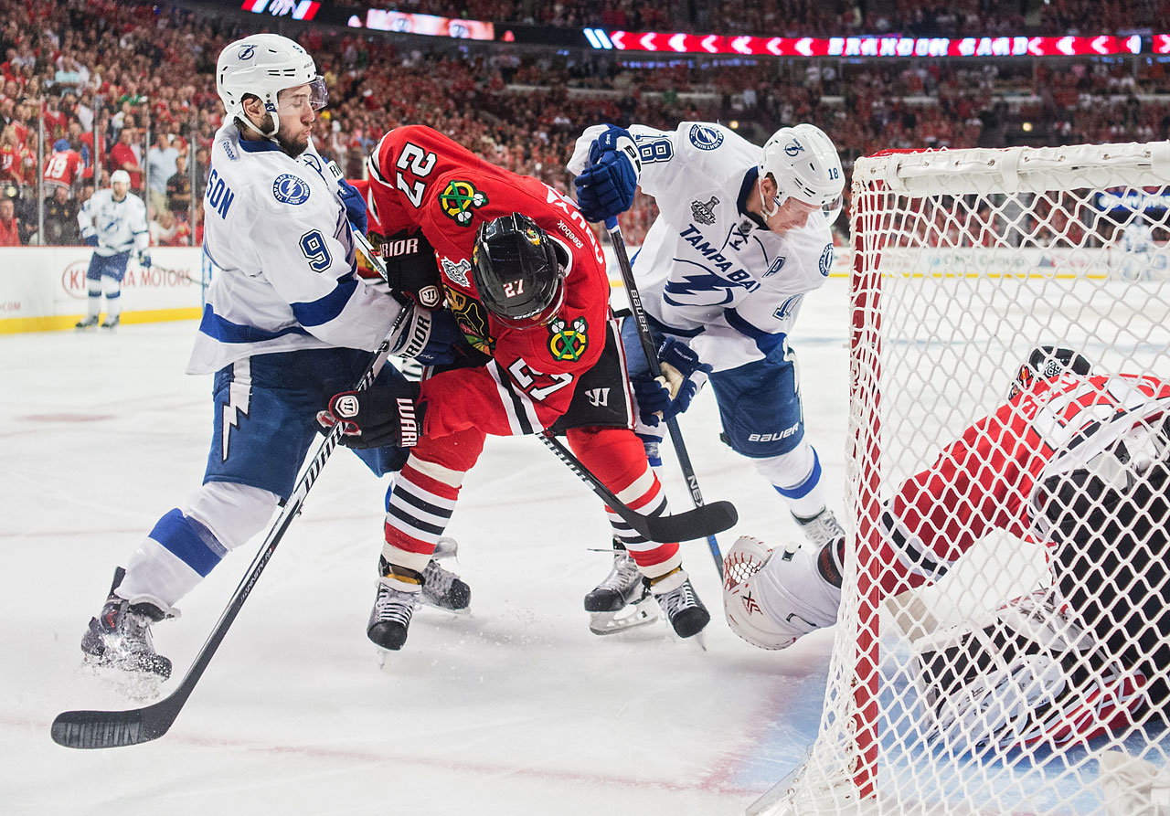 The Lightning also got goals out of Ryan Callahan and Ondrej Palat. Here, Johnny Oduya (27) of the Blackhawks battles to clear the puck from the Chicago zone.