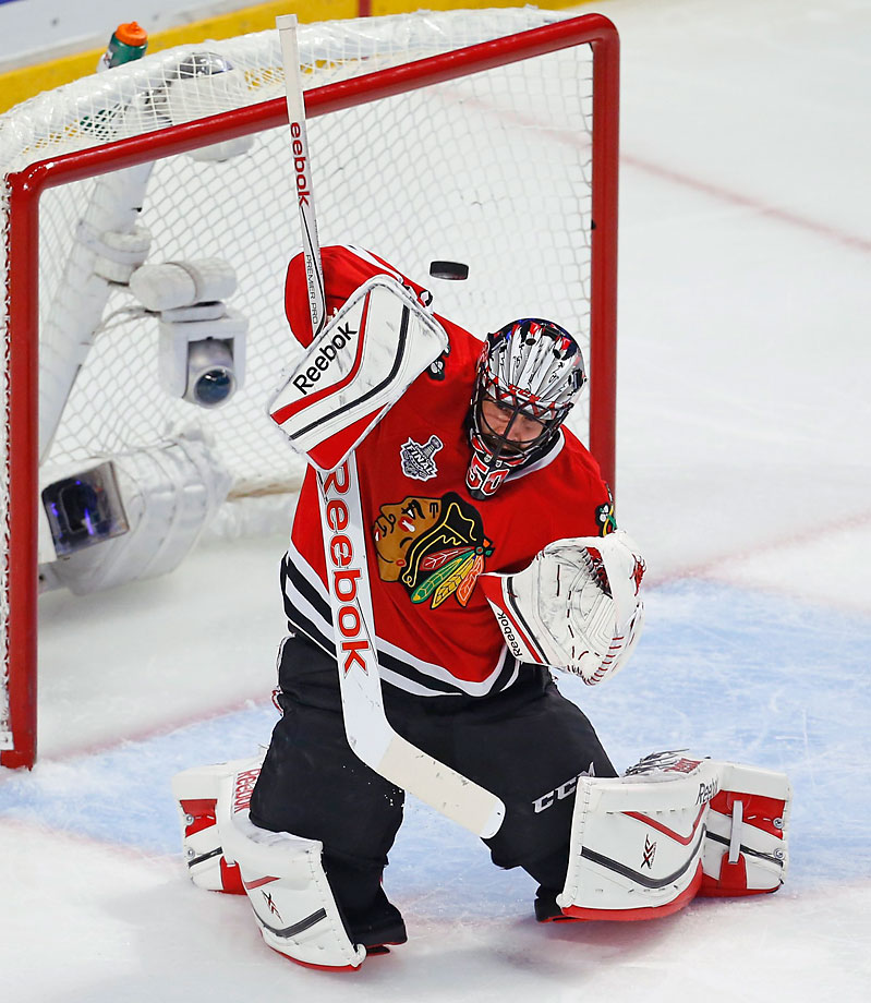 Corey Crawford deflects the puck.