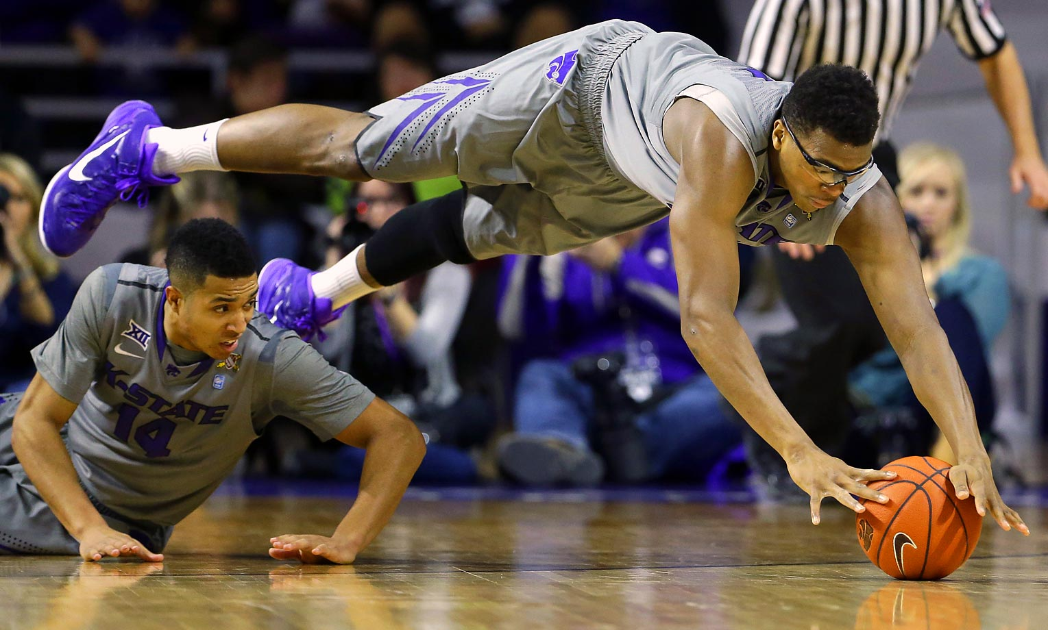 Kansas State's Stephen Hurt dives for a loose ball against Baylor.