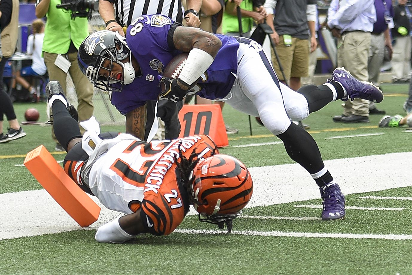 Steve Smith dives over Cincinnati cornerback Dre Kirkpatrick for a touchdown.