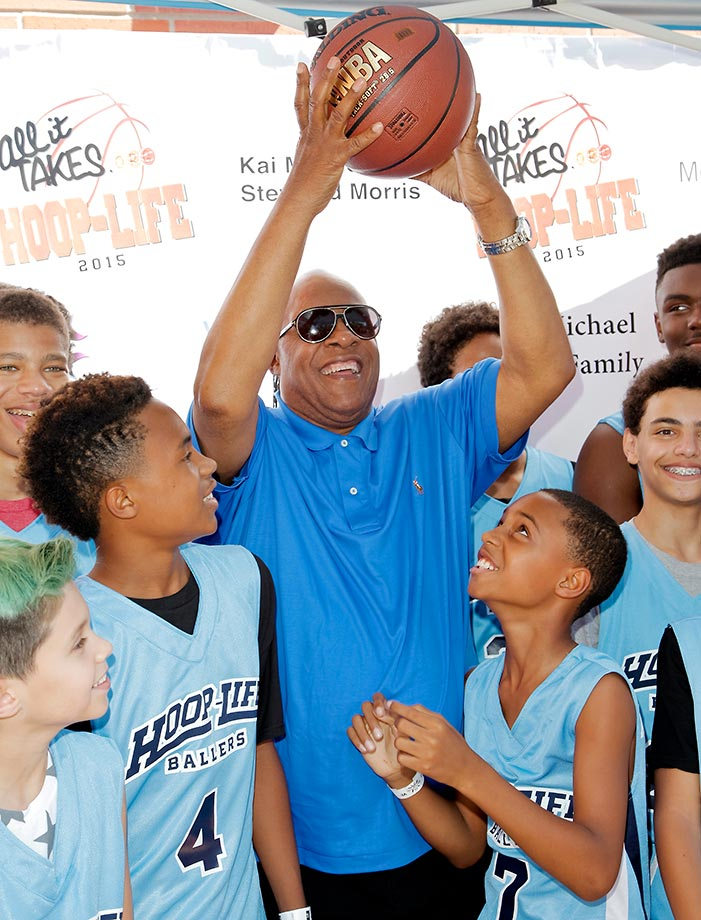 Stevie Wonder plays around with his sons, Kailand Morris (left) and Mandla Morris, at the 3rd annual Hoop-Life FriendRaiser at Galen Center in Los Angeles.