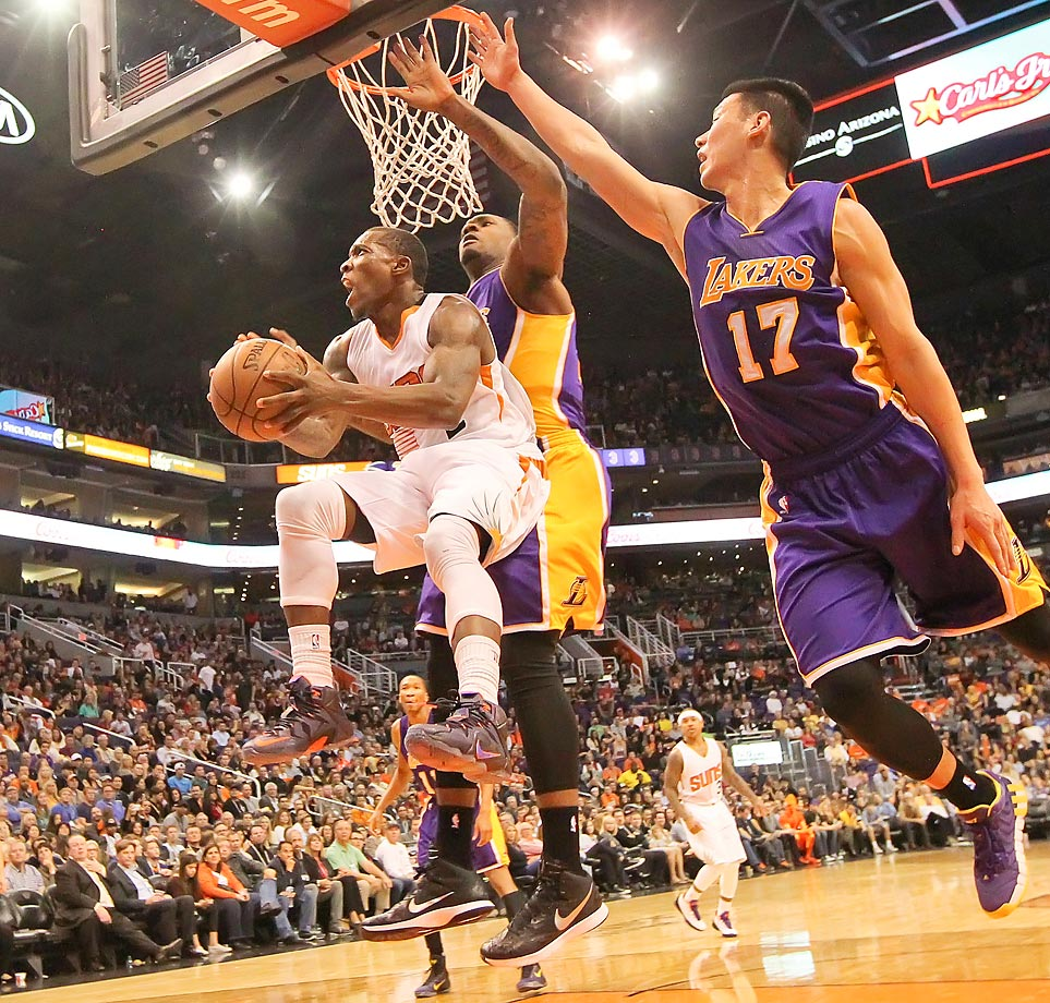 Los Angeles Lakers guard Jeremy Lin (17) tries to block Phoenix Suns guard Eric Bledsoe at the US Airways Center in Phoenix.