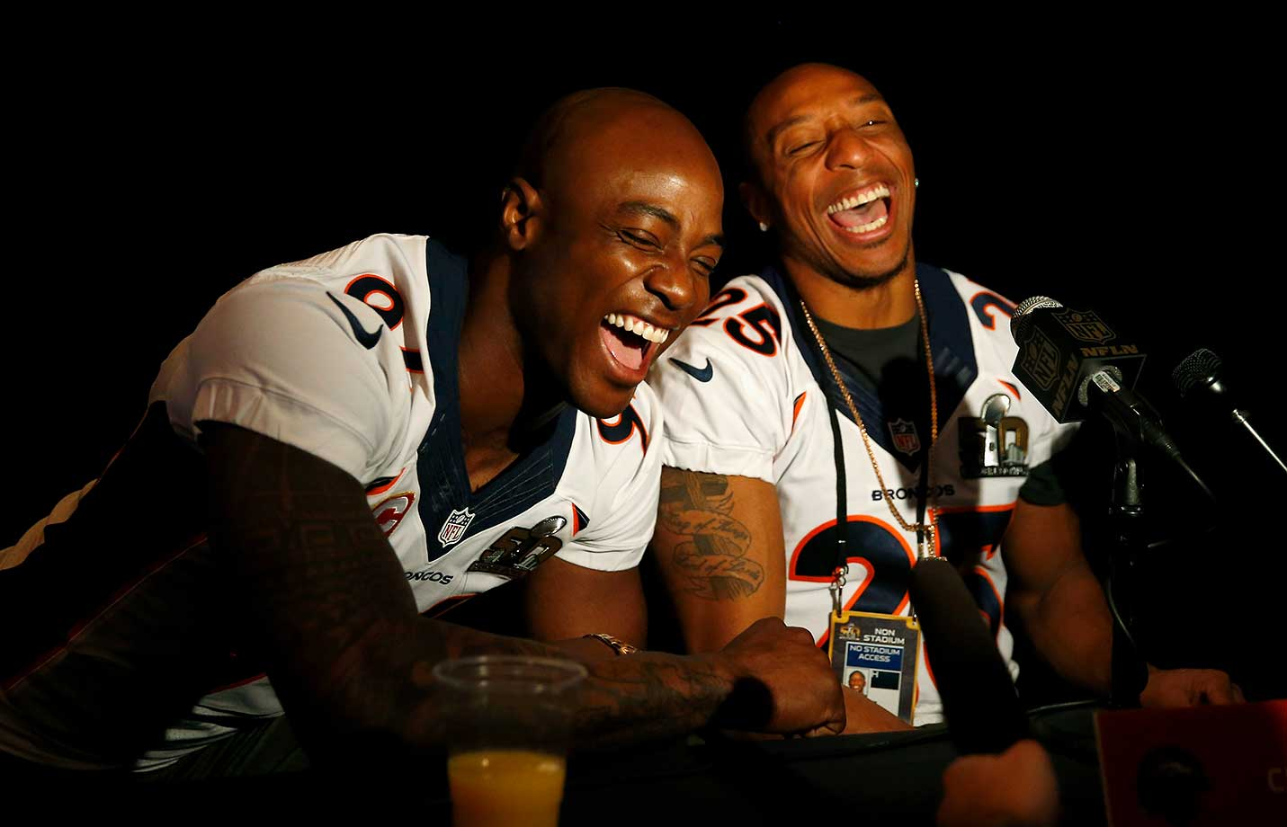 DeMarcus Ware and Chris Harris Jr. of the Denver Broncos joke around as they speak during the Broncos media availability at the Santa Clara Marriott.