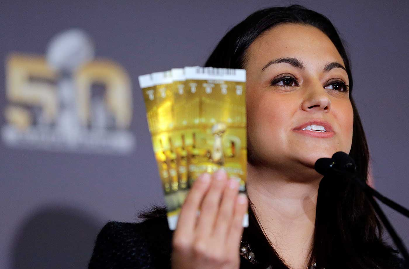 Dolores F. Dibella, NFL Counsel, holds up authentic Super Bowl 50 tickets during a counterfeit merchandise news conference Thursday in San Francisco.