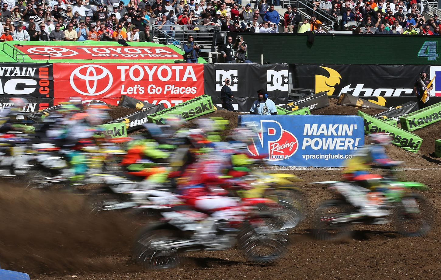 Motorcycles roar out of the gates in front of thousands of fans at Metlife Stadium.