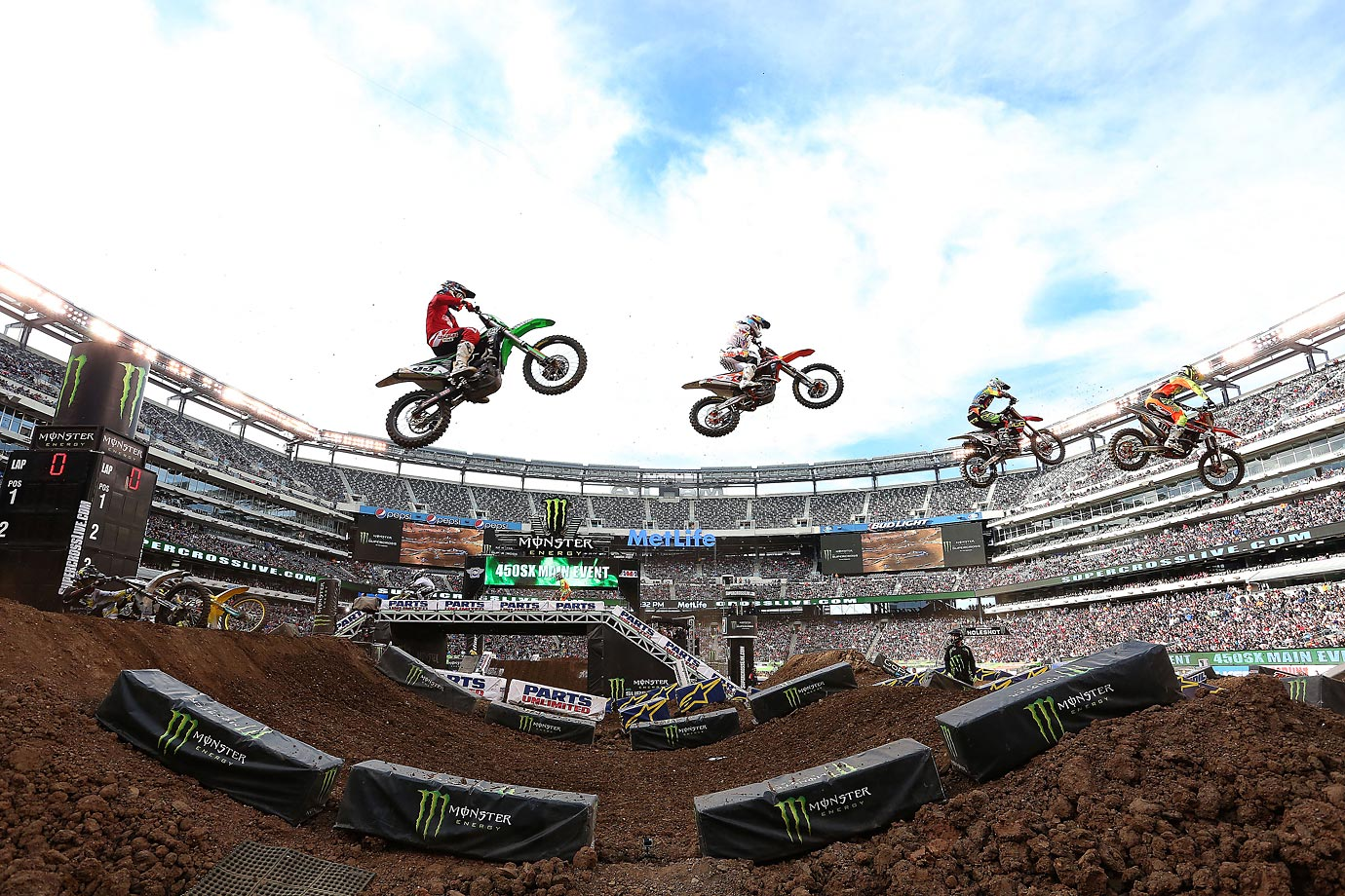 Dungey (#5) and other riders get some big air.