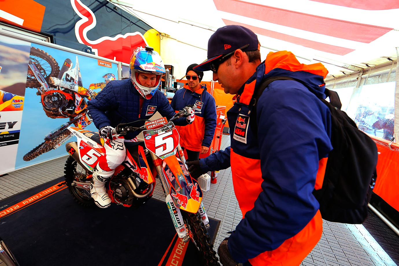 Dungey and members of his team prepare for practice runs.