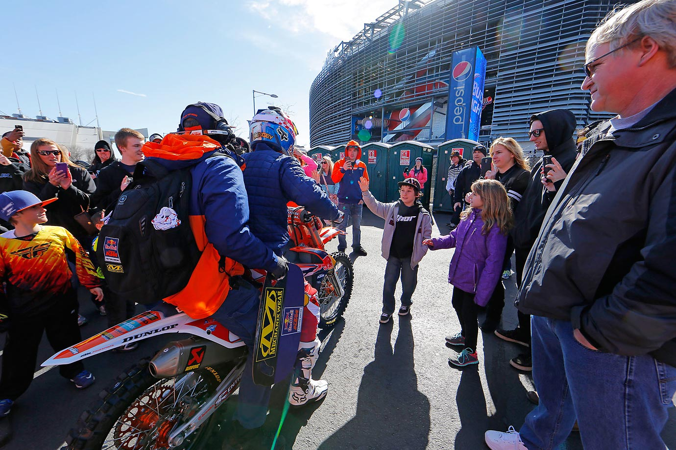 Fans greet Dungey as he heads to the track for practice runs.