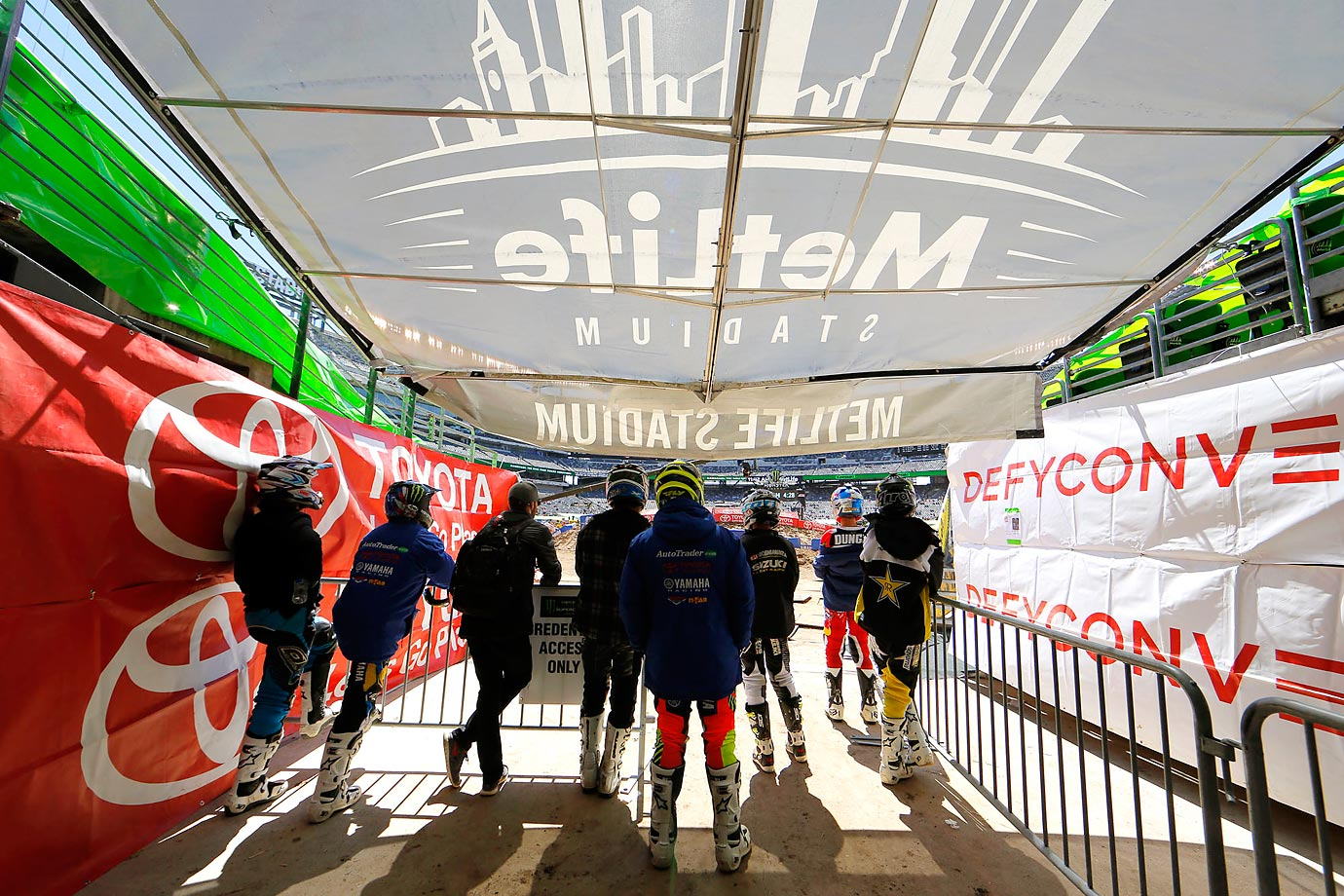 Supercross riders survery the track before Saturday's event at Metlife Stadium.
