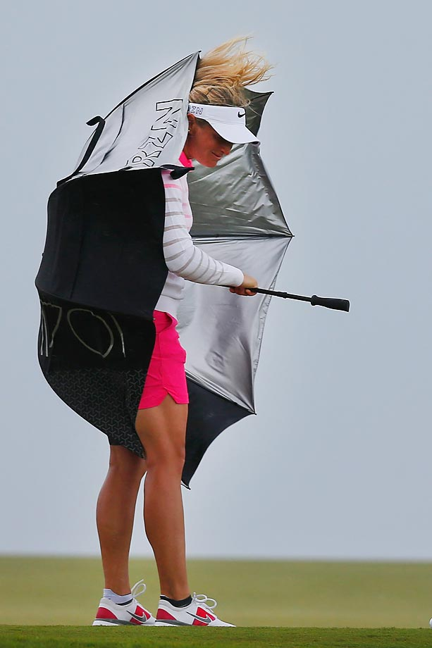 Suzann Pettersen has trouble with an umbrella during round one of the Pure Silk Bahamas LPGA Classic at the Ocean Club course on Paradise Island, Bahamas.