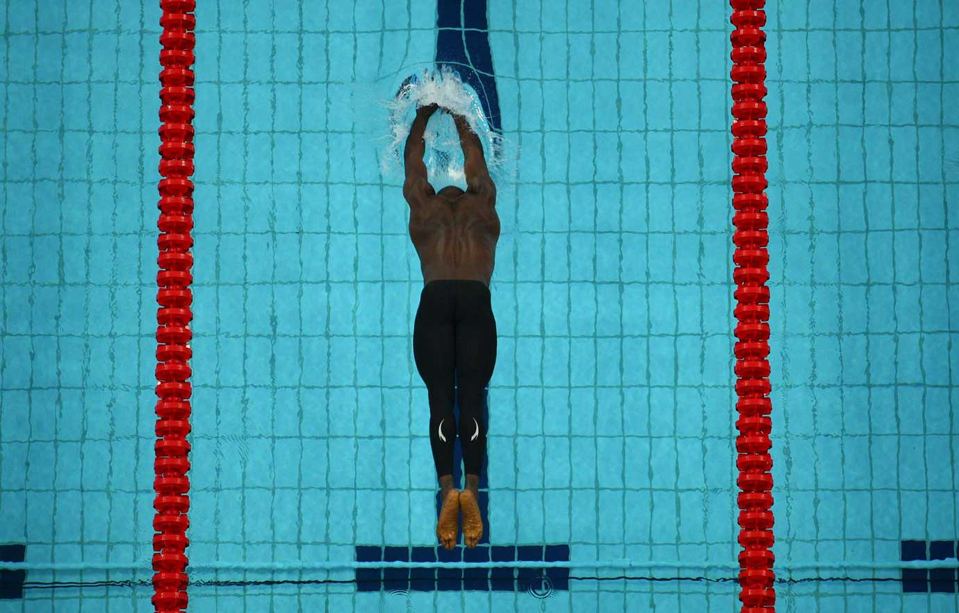 Yei Yah of Nigeria in a heat of the 50-meter freestyle at the 2008 Olympic Games in Beijing.