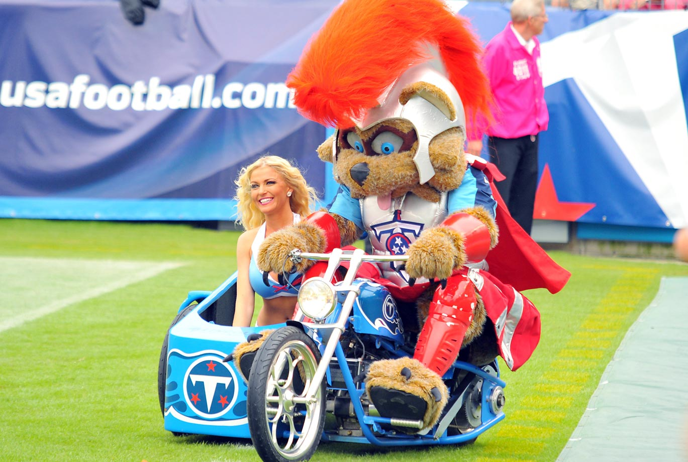 Titans mascot T-Rac gives a motorcycle ride to a Titans cheerleader at LP Field in Nashville.
