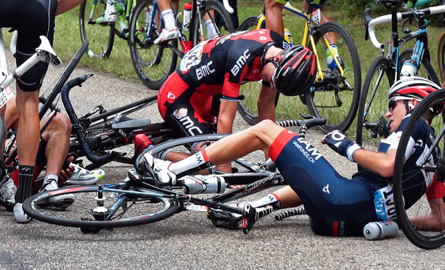 Tejay van Garderen of the U.S., center top, and Switzerland's Sebastien Reichenbach, right, crash during the seventh stage of the Tour de France cycling race over 234.5 kilometers (145.7 miles) with start in Epernay and finish in Nancy, France, Friday, July 11, 2014.