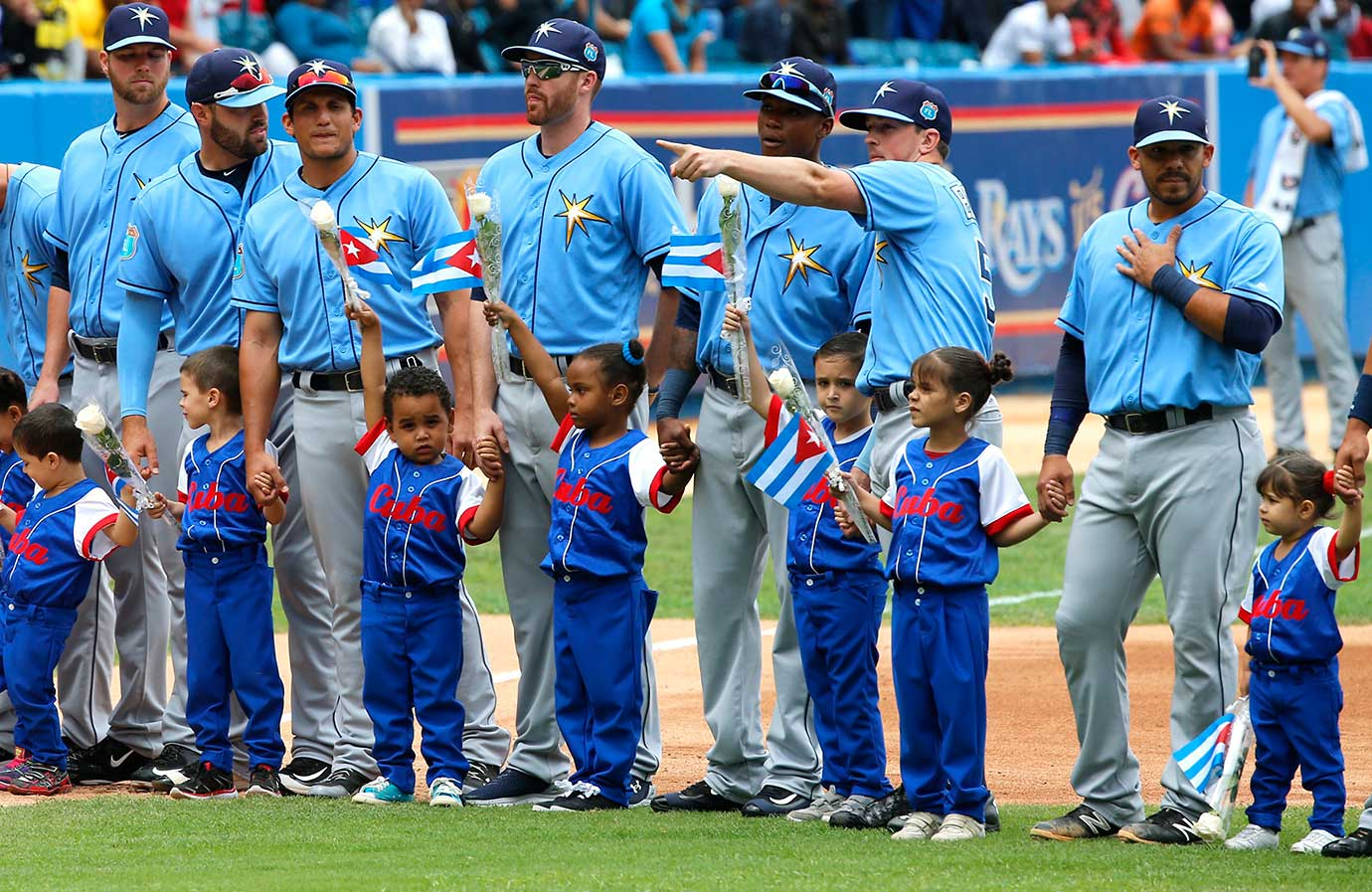 The Tampa Bay Rays with Cuban children before the game at the Estadio Latinoamericano in Havana, Cuba.