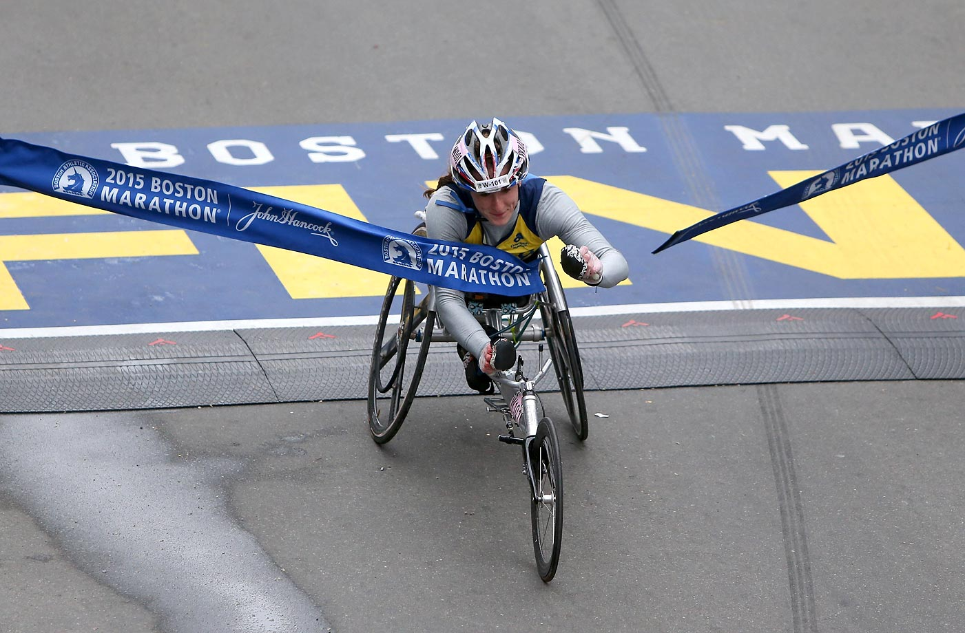 Tatyana McFadden of the United States crosses the finish line to win the women's push rim wheelchair division.