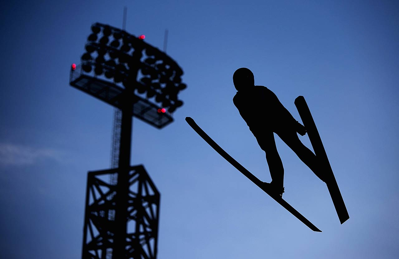 Taylor Henrich of Canada jumps during the Ladies' Normal Hill Individual Ski Jumping training.