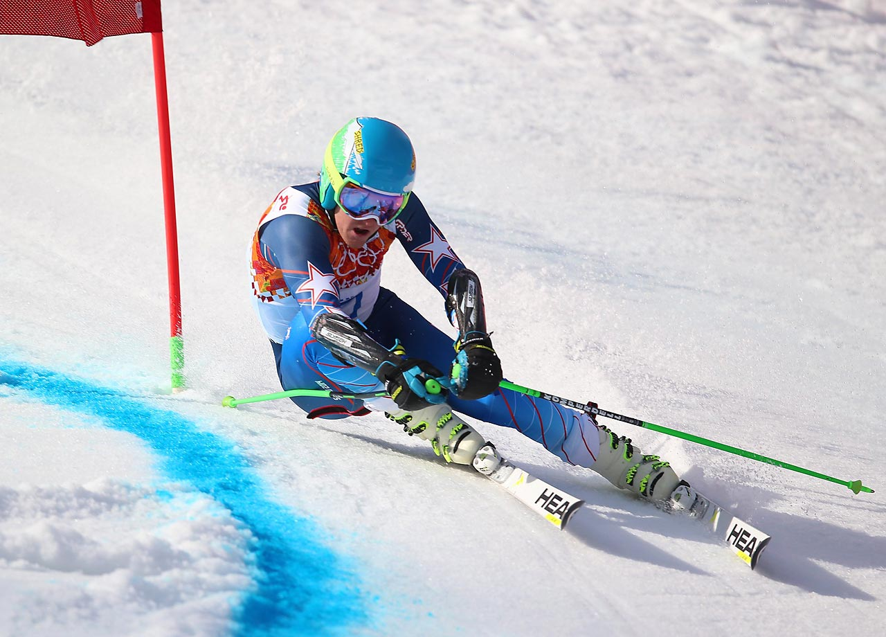 American skier Ted Ligety cruises past a gate en route to winning the gold medal in the men's giant slalom competition.