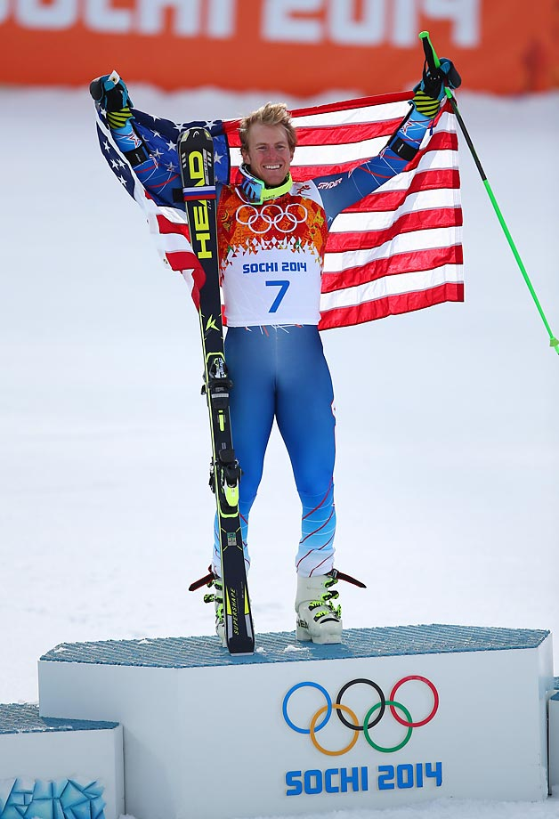 Ted Ligety holds the American flag on the podium as he celebrates his gold medal.