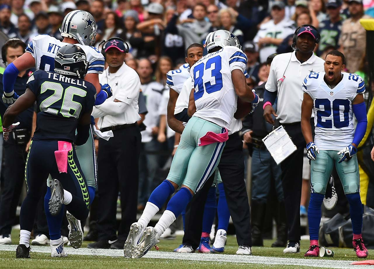 Terrance Williams of the Dallas Cowboys makes a pivotal fourth-quarter catch for a first down in Dallas' 30-23 victory in Seattle.