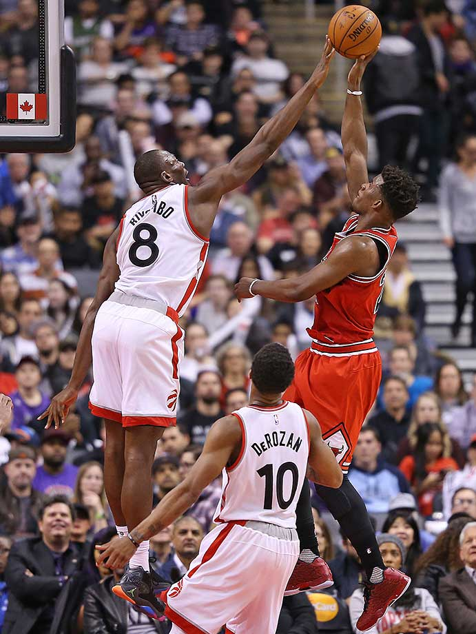 Jimmy Butler of the Chicago Bulls is denied by Bismack Biyombo of the Toronto Raptors.