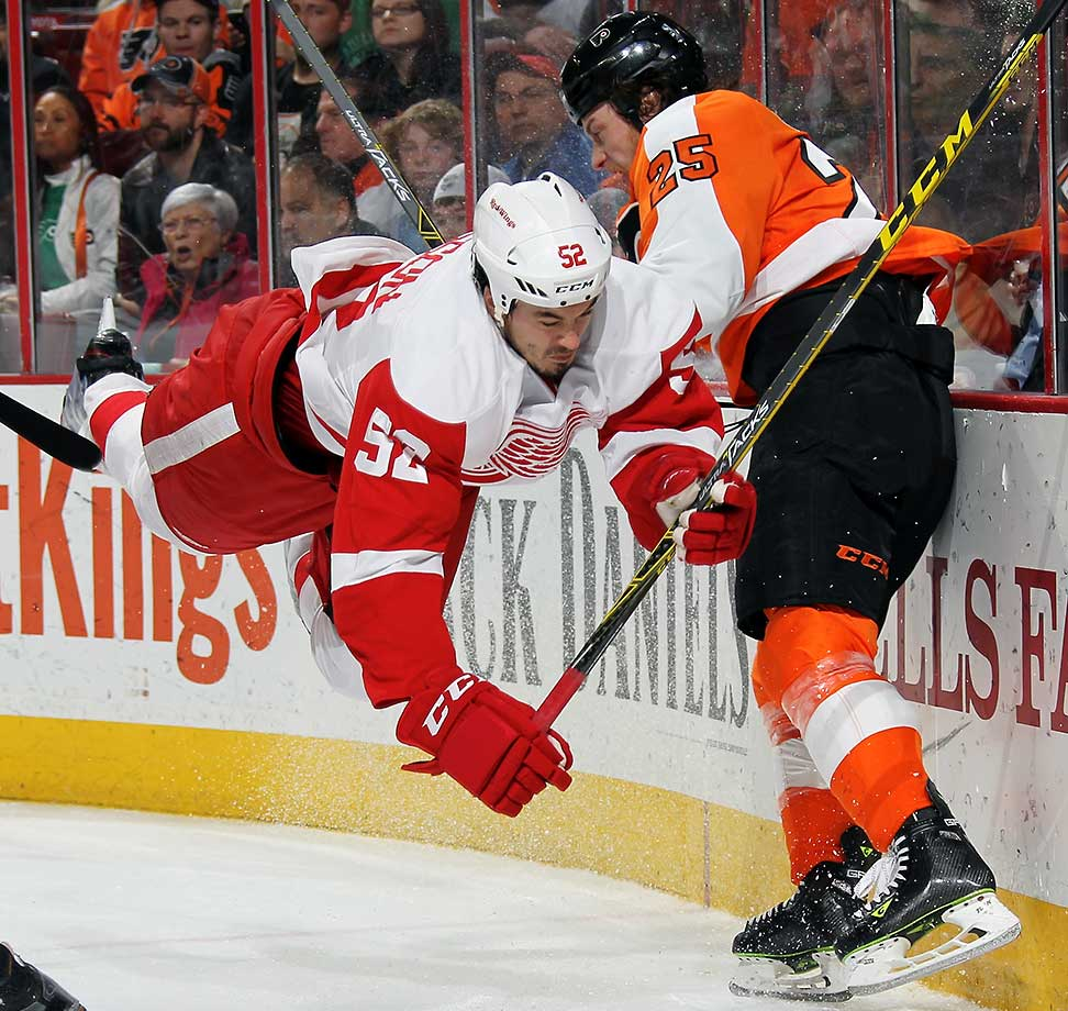 Jonathan Ericsson (52) of the Detroit Red Wings collides with Ryan White of the Philadelphia Flyers.