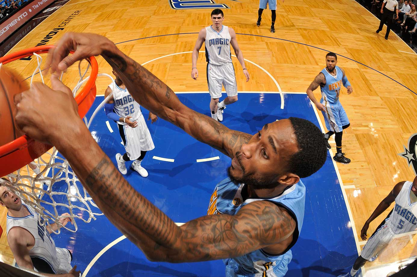 Will Barton of the Denver Nuggets dunks against the Orlando Magic.