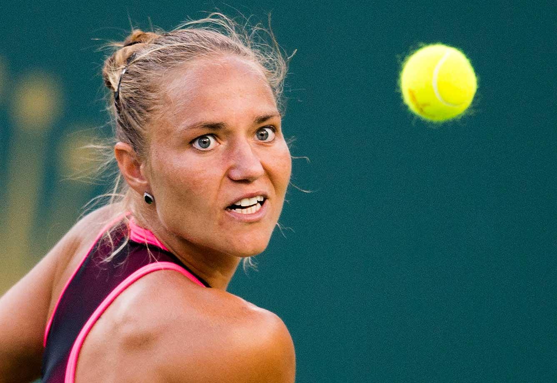 Kateryna Bondarenko of Ukraine returns a shot to Serena Williams at the BNP Paribas Open at Indian Wells.