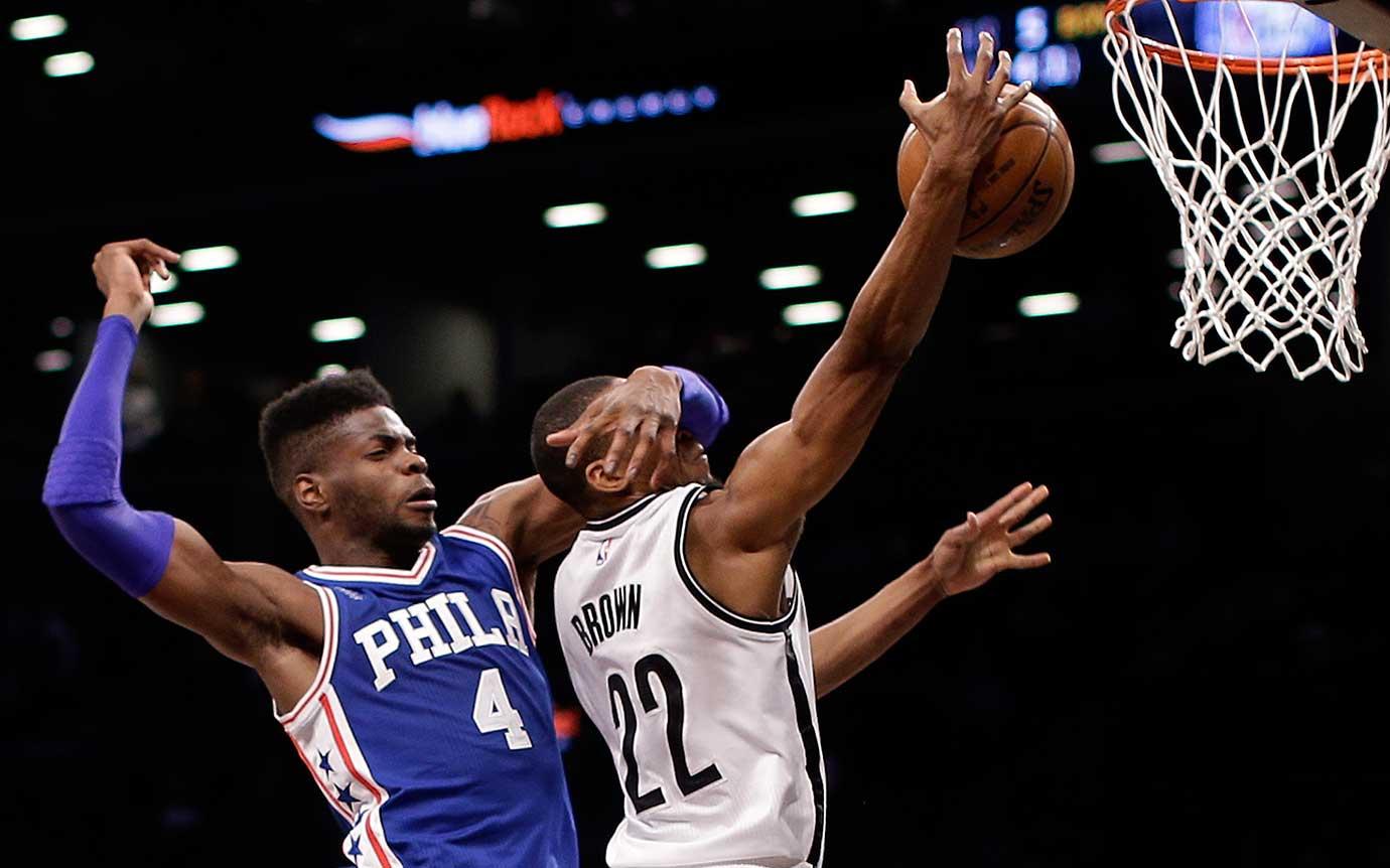 Brooklyn Nets guard Markel Brown is fouled while shooting by Philadelphia's Nerlens Noel .