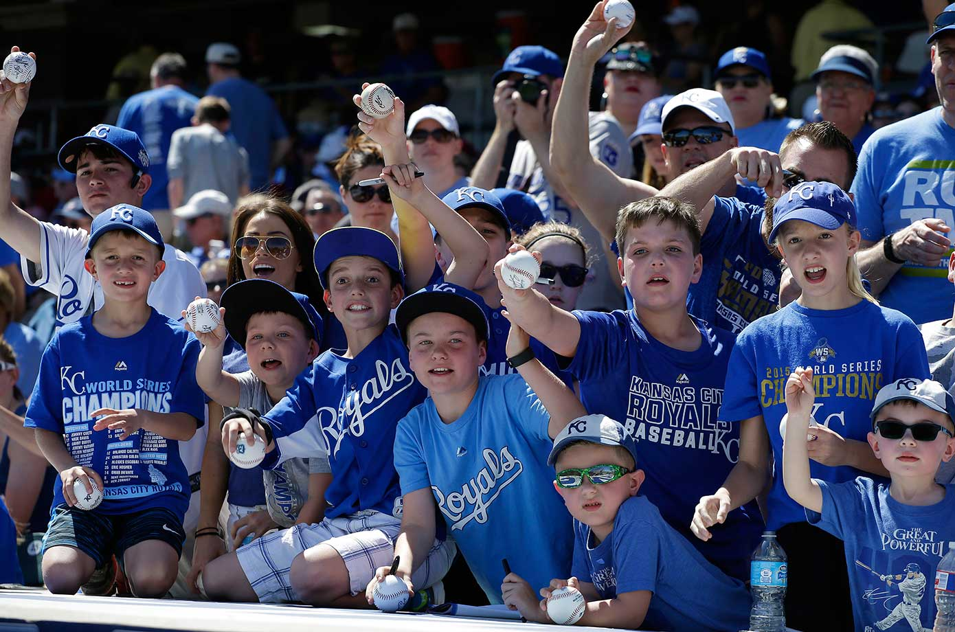 Fans wait for autographs before a spring training baseball game between the Kansas City Royals and the Chicago Cubs.