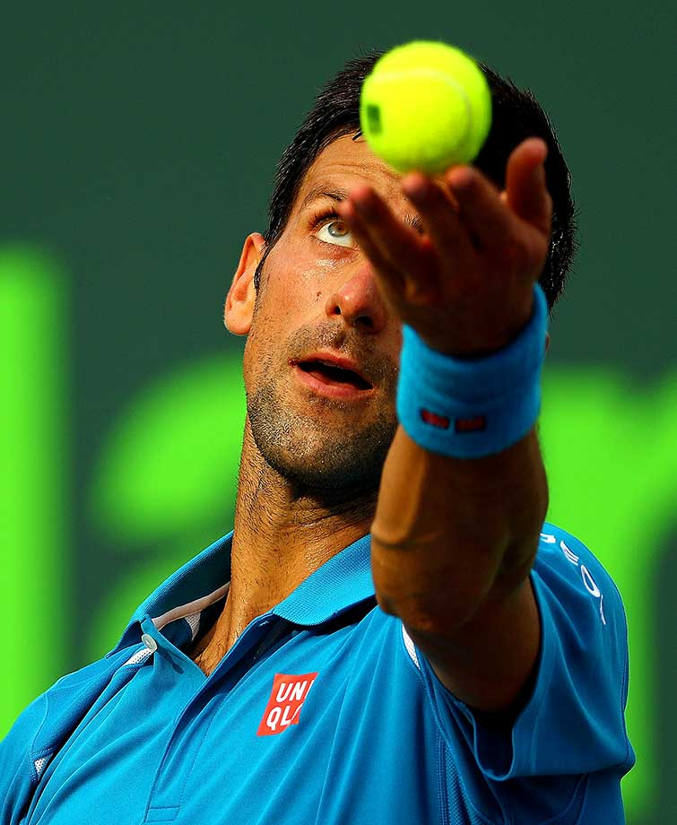Novak Djokovic serves during a match against Dominic Thiem of Austria during Day 9 of the Miami Open.