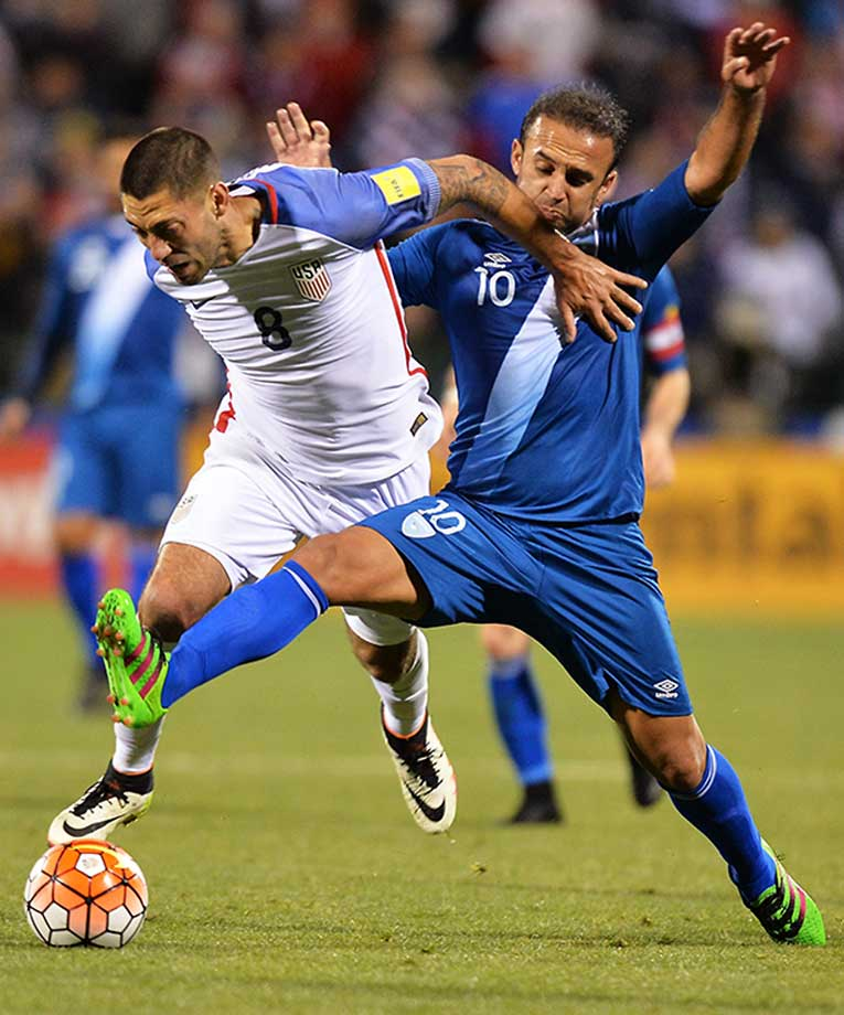 Clint Dempsey and Jose Contreras of Guatemala battle for control of the ball.