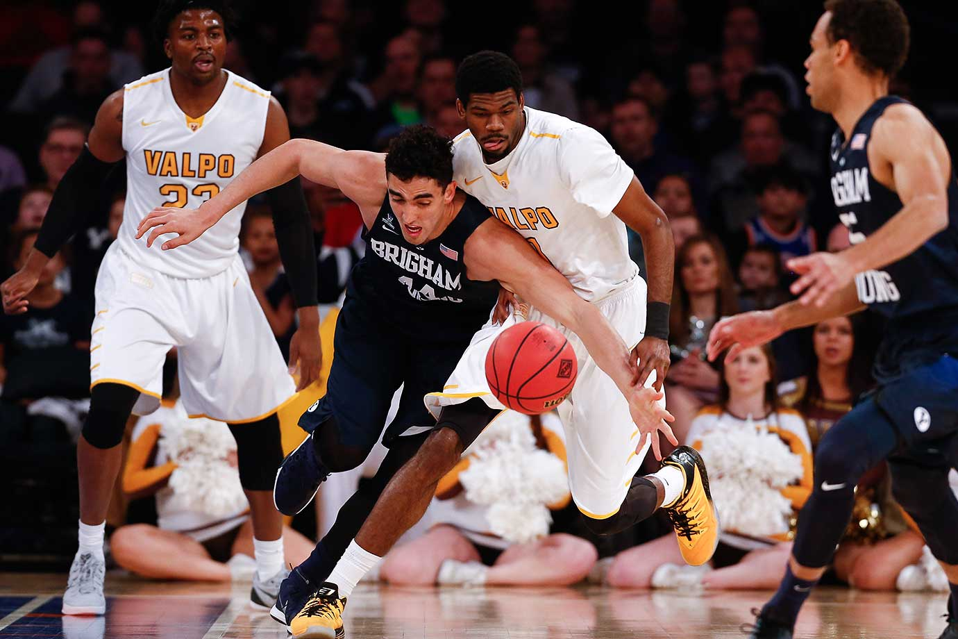 Corbin Kaufusi of Brigham Young fights for the ball with E. Victor Nickerson of Valparaiso during their NIT Championship semifinal game.