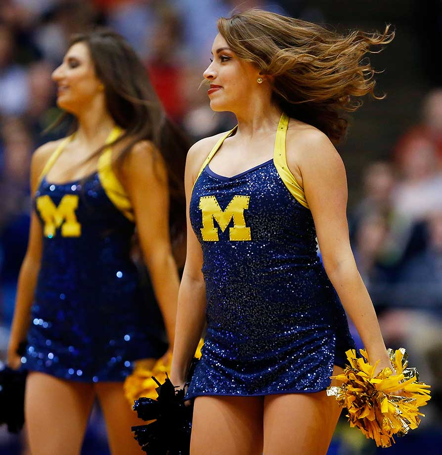 Michigan cheerleaders perform against the Tulsa Golden Hurricane.