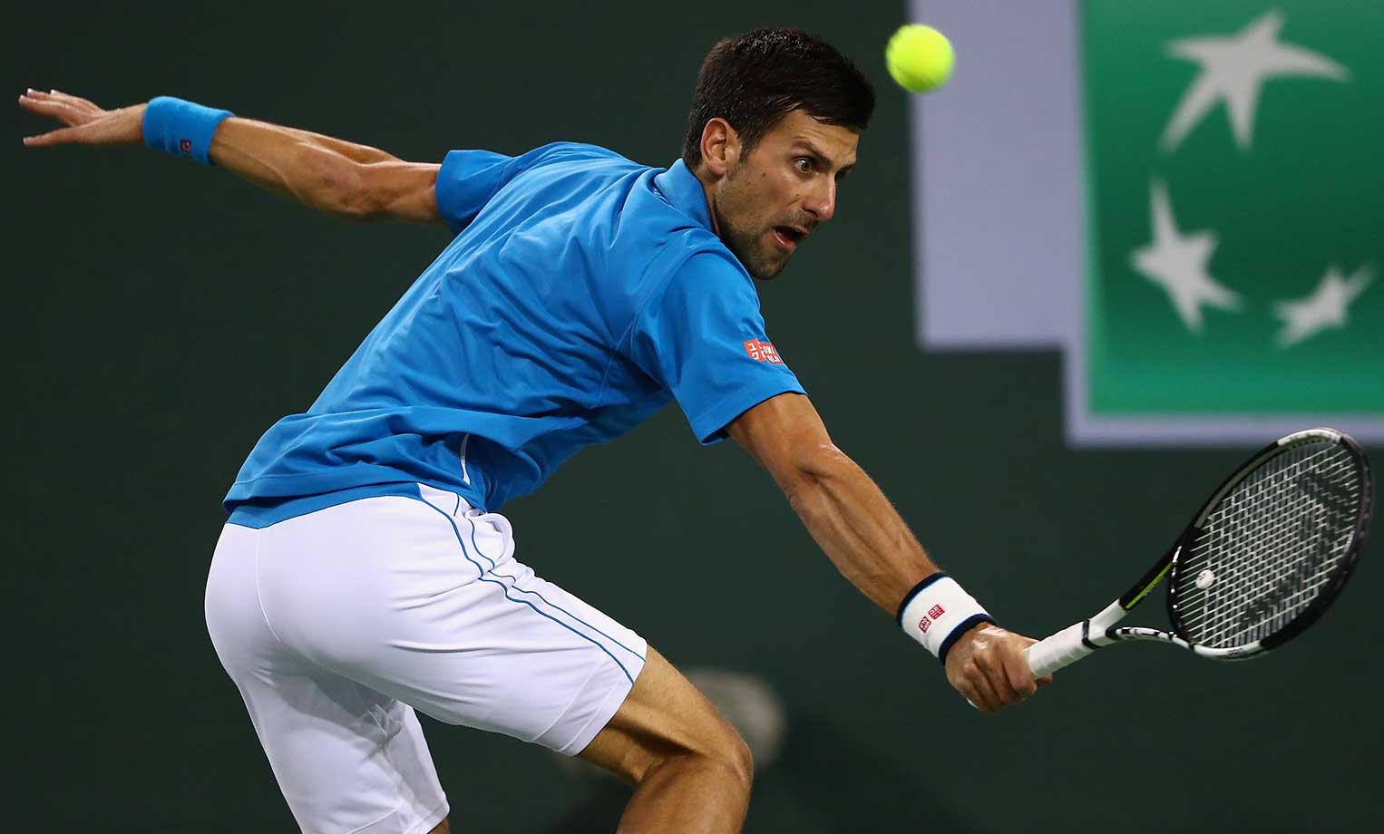 Novak Djokovic plays a backhand in his match against Feliciano Lopez of Spain.