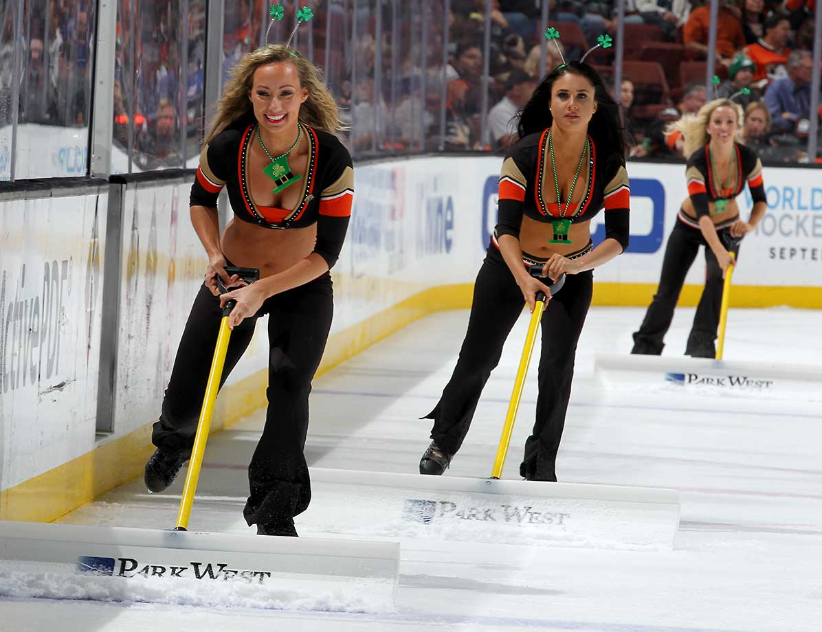Members of the Power Players tend to the ice during the game between the Anaheim Ducks and the New York Rangers.