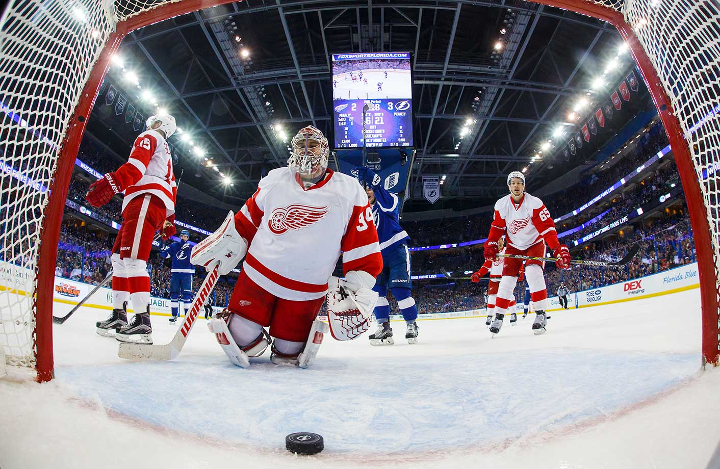 Goalie Petr Mrazek, Riley Sheahan and Danny DeKeyser of Detroit react to a goal against as Ondrej Palat of Tampa Bay celebrates.