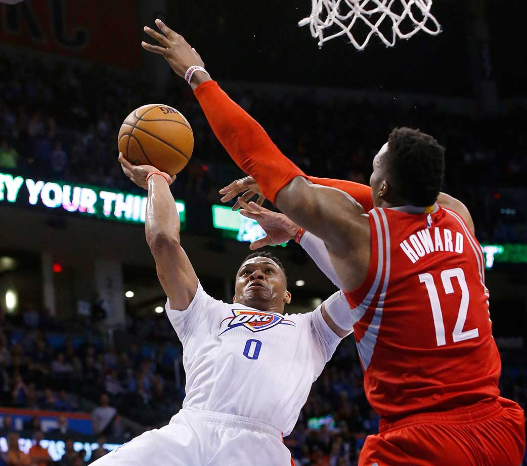Oklahoma City Thunder guard Russell Westbrook shoots as Houston Rockets center Dwight Howard defends. Westbrook notched his third straight triple-double in the game.
