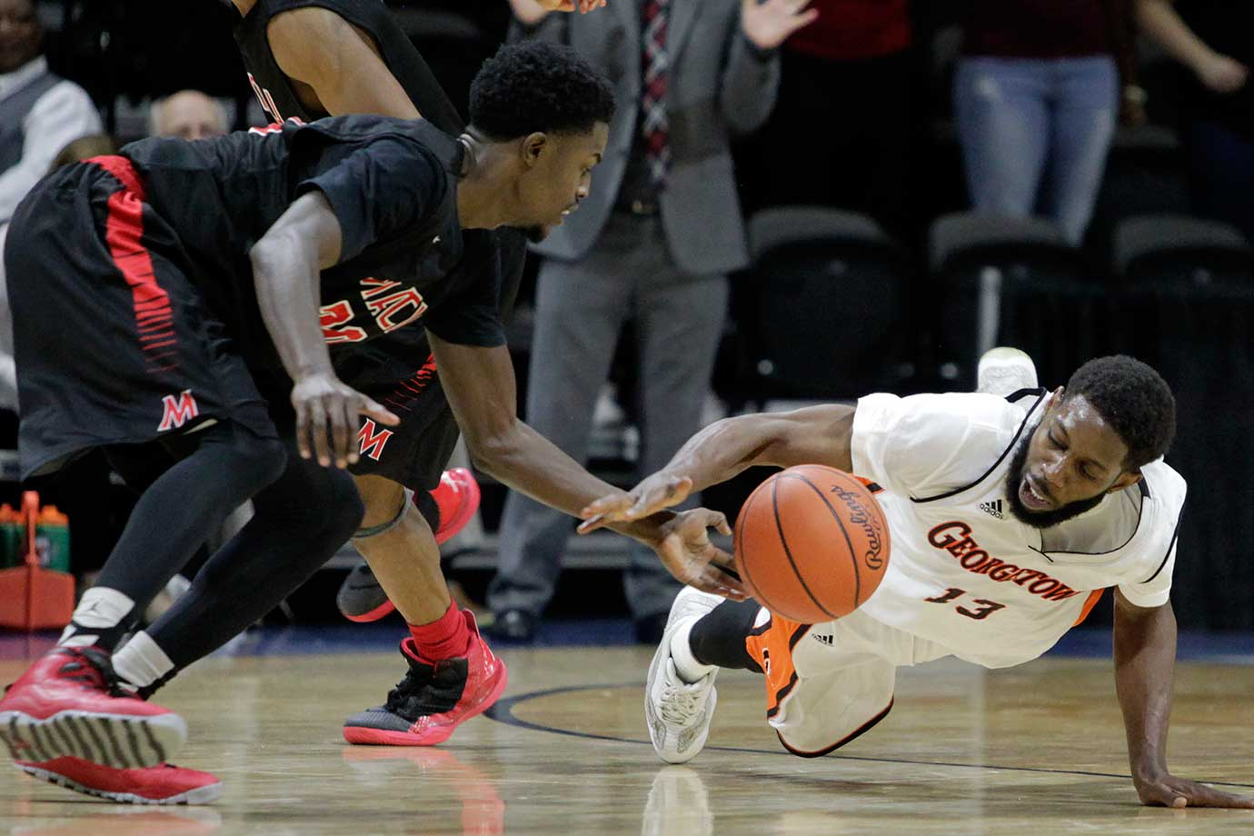 Mid-America Christian's Bryon Miller and Georgetown (Ky.) guard Tony Kimbro go after a loose ball during the NAIA championship game in Kansas City, Mo. Mid-America Christian won 100-99 in overtime.