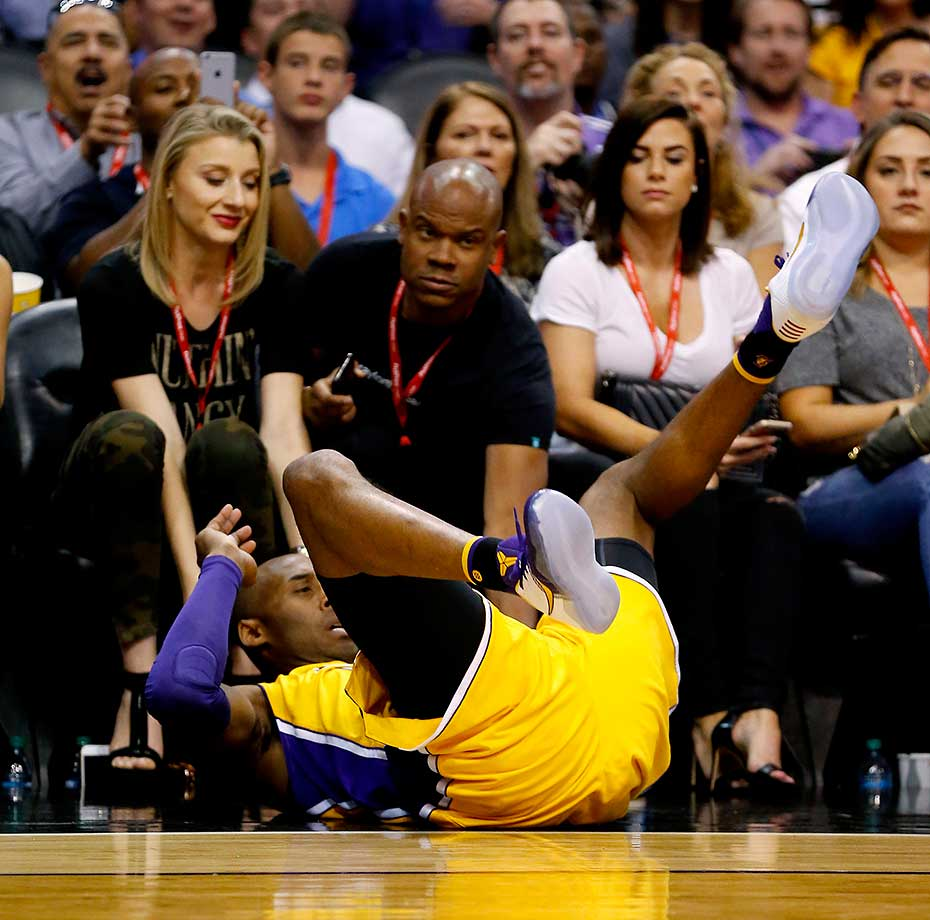 Los Angeles Lakers forward Kobe Bryant falls after being fouled against the Phoenix Suns.