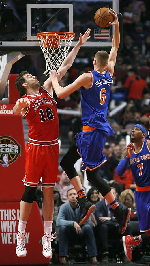 Kristaps Porzingis of the New York Knicks dunks over Chicago Bulls' Pau Gasol during a 115-107 victory.