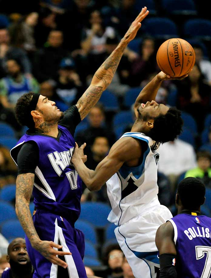 Minnesota's Andrew Wiggins shoots and draws a foul against Willie Cauley-Stein of Sacramento.